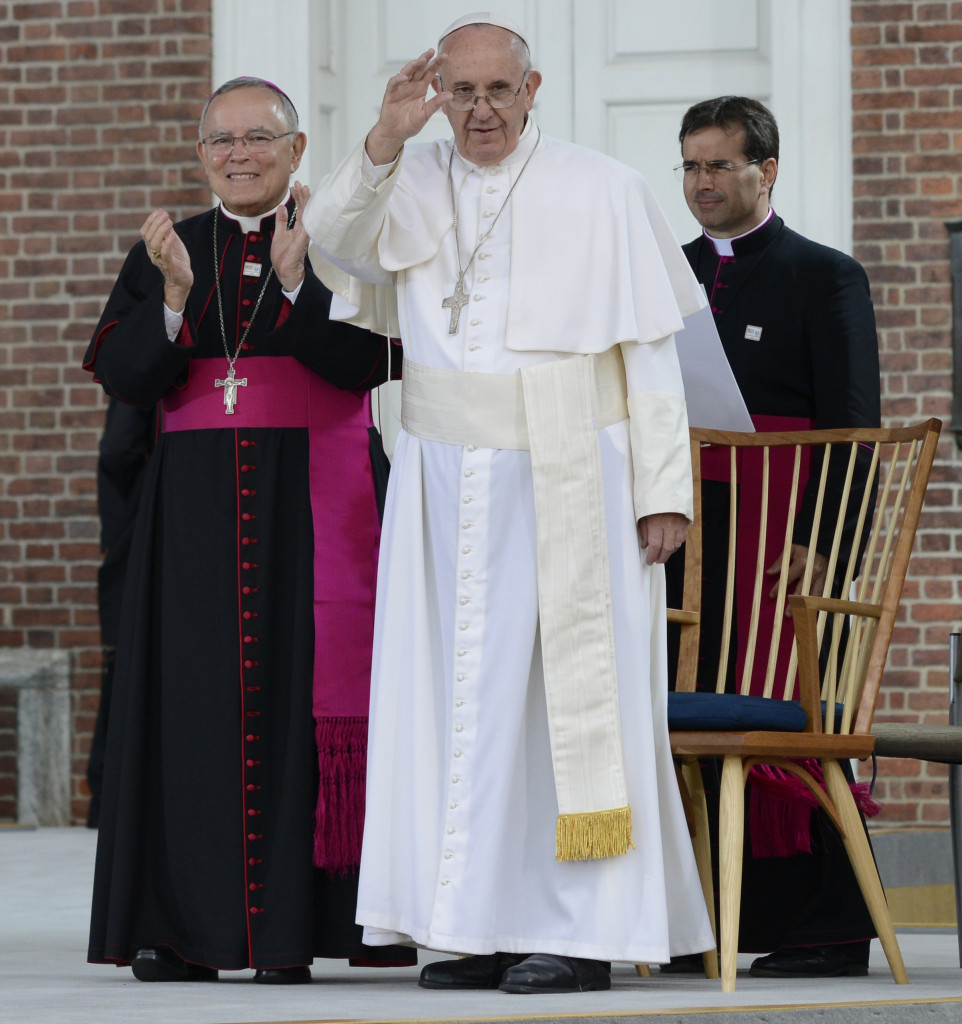 Pope Francis waves to the crowd at Independence Hall in Philadelphia, Saturday, Sept. 26, 2015. The pontiff discussed immigration during his address. (U.S. Coast Guard photo by Chief Petty Officer Nick Ameen)