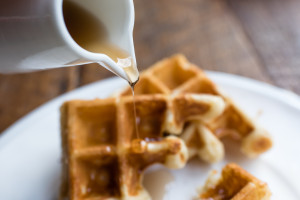 Waffle with Pouring Maple Syrup