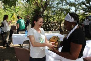 Lisa Curtis with moringa superfood in Haiti