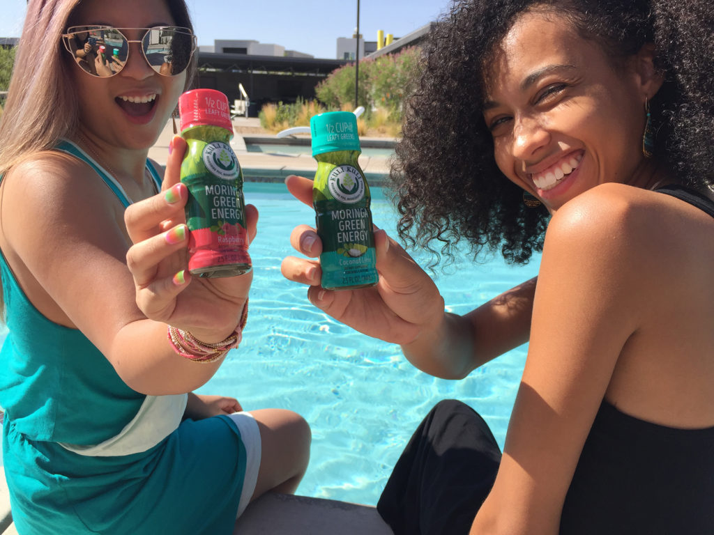 Friends enjoying Kuli Kuli Moringa Green Energy Shots