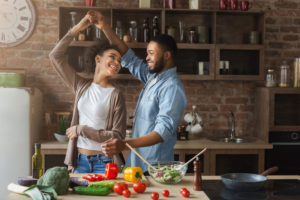 Couple cooking and dancing in the kitchen