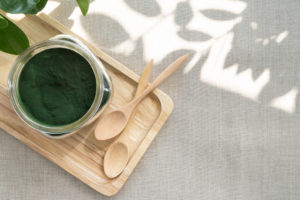 Spirulina with wooden spoons
