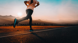 Woman running on open road