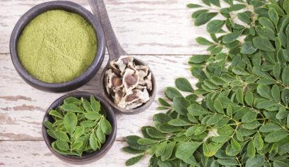 Moringa powder, leaves, and seed pods.