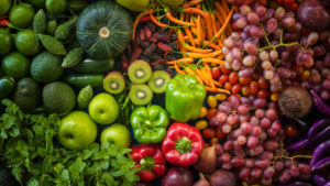an array of colorful fruits and veggies