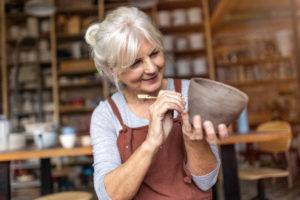 Adult female enjoying pottery