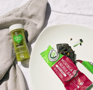 Probiotic green juice shot and moringa bar on table